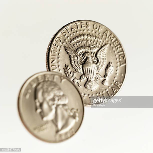 Close-up of an American fifty cent coin and a quarter
