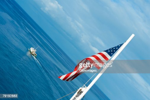 Close-up of an American flag fluttering : Stock Photo