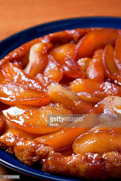 Close-up of an apple tarte tatin in a blue bowl