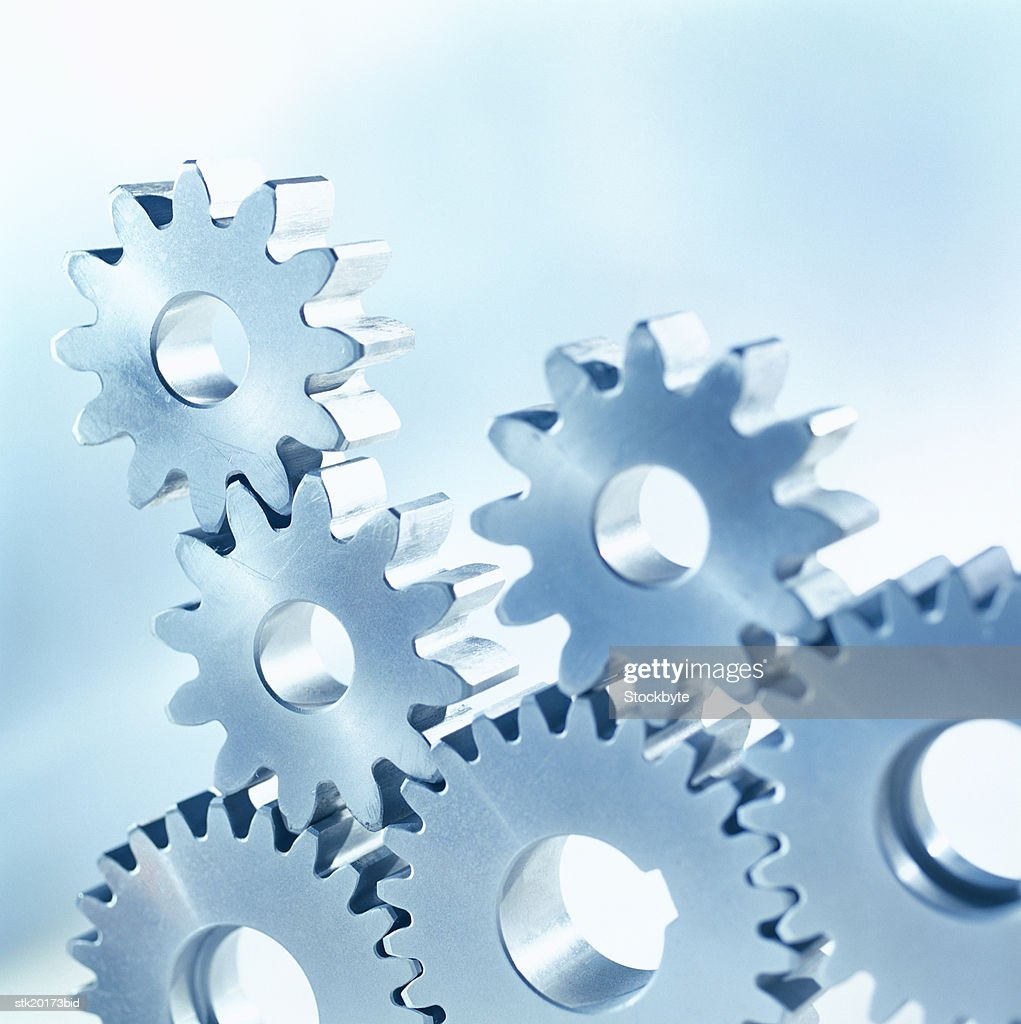 close-up of an array of upright gear wheels : Stock Photo