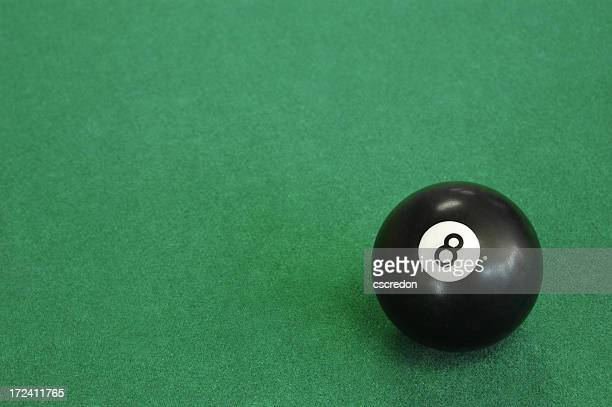 Close-up of an eight ball on pool table