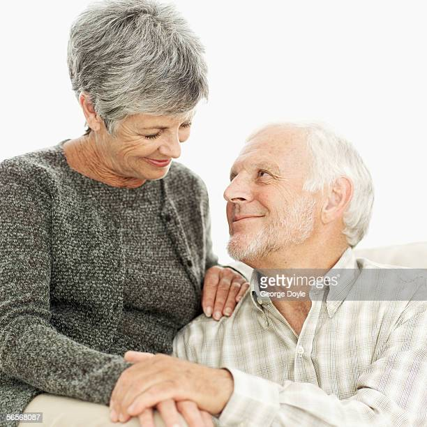 close-up of an elderly couple sitting on a sofa