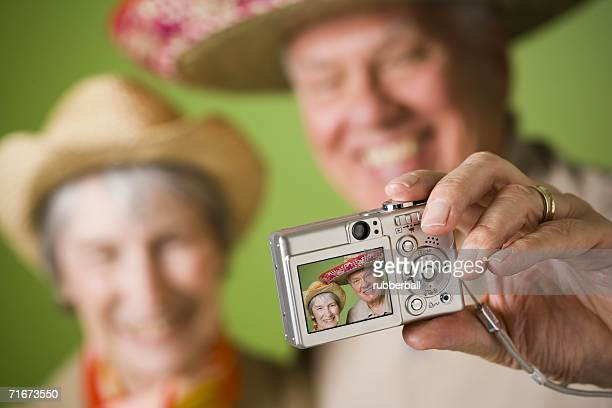 Close-up of an elderly couple taking a photograph of themselves