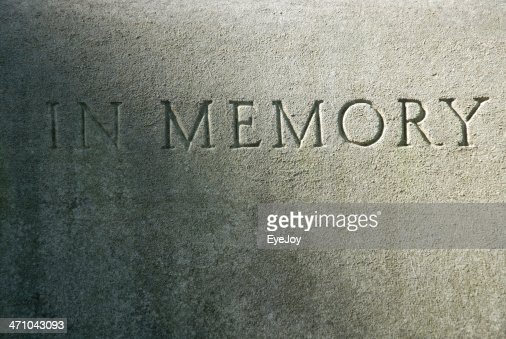 Close-up of an engraving on a cement grave