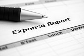 Close up of pen on expense report