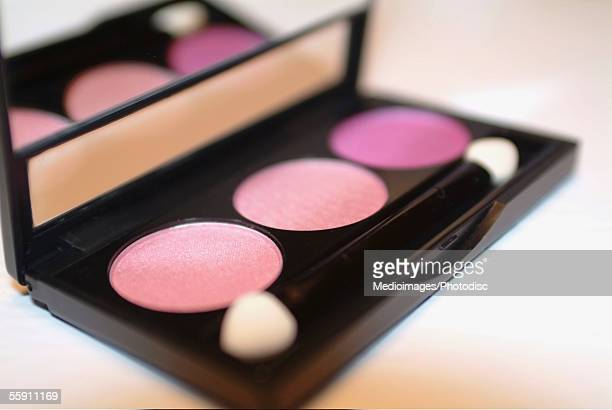 Close-up of an eyeshadow palette and brush