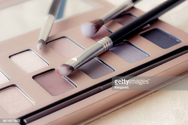 Close-up of an eyeshadow palette and brushes