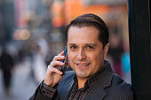 Close-up of an Hispanic businessman talking on a mobile phone