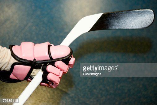 Close-up of an ice hockey player's hand holding an ice hockey stick : Stock Photo