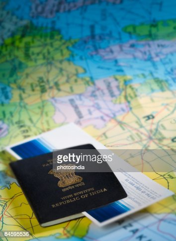 Closeup of an indian passport with an airline ticket on a for Airline tickets buy now pay later