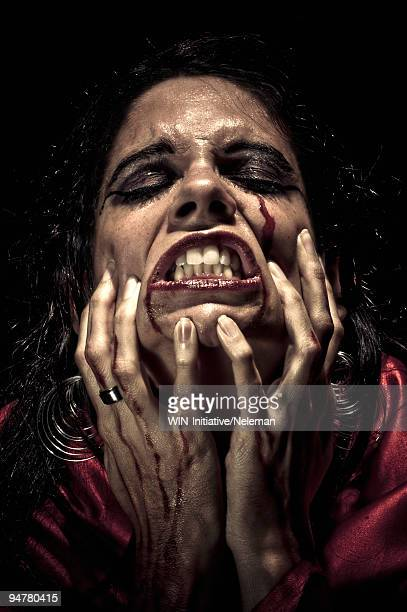 Close-up of an injured woman screaming