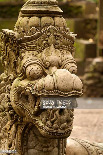 Closeup of an old dragon statue in Ubud