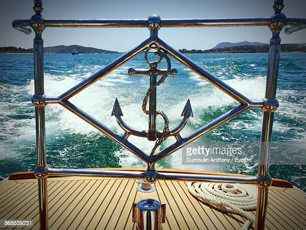 Close-Up Of Anchor Sculpture On Boat In Sea