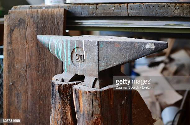 Close-Up Of Anvil On Wood