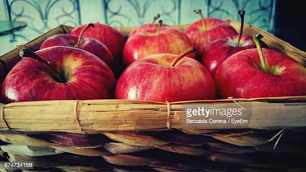 Close-Up Of Apples In Wicker Basket At Home
