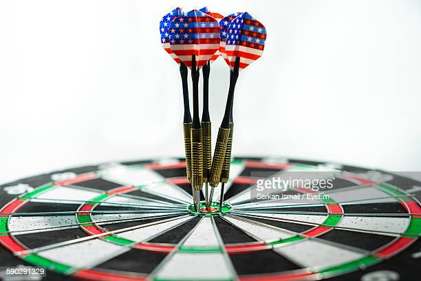 Close-Up Of Arrows On Bull-Eye Against White Background