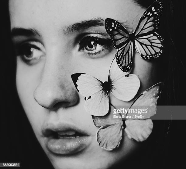 Close-Up Of Artificial Butterflies On Beautiful Woman Face