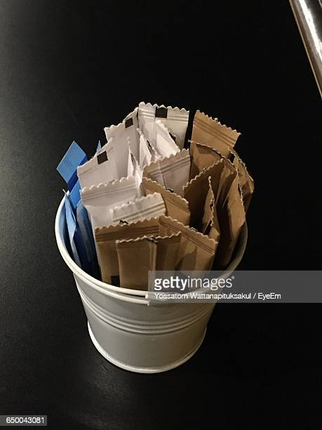 Close-Up Of Artificial Sweeteners In Container On Table