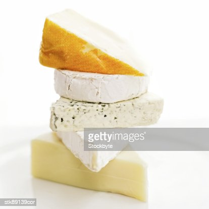 close-up of assorted cheeses piled one on top of the other : Stock Photo