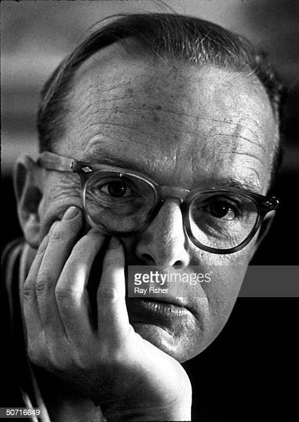 Closeup of author Truman Capote looking thoughtful during an interview at a friend's home