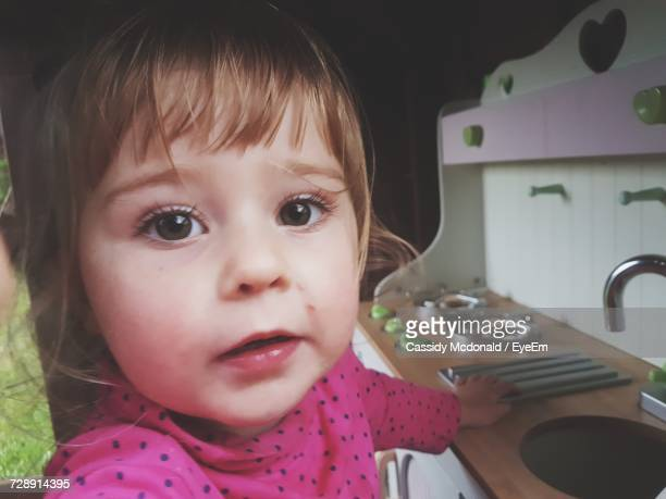 Close-Up Of Baby Girl In Kitchen At Home