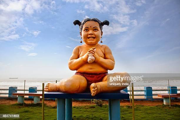 Close-up of baby girl statue at beach, Visakhapatnam, Andhra Pradesh, India