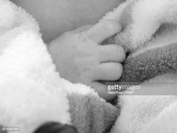 Close-up of baby hand in blanket