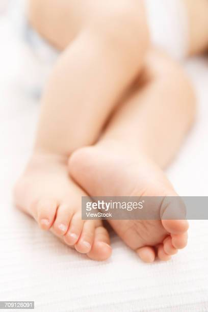 Close-up of babys feet and legs