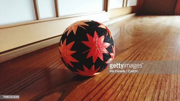 Close-Up Of Ball On Hardwood Floor At Home