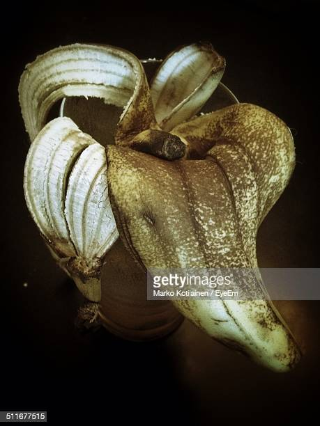 Close-up of banana peel in a glass