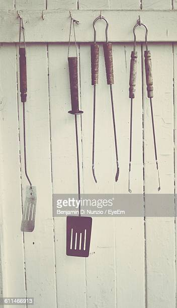Close-Up Of Barbeque Tools Hanged On Hook