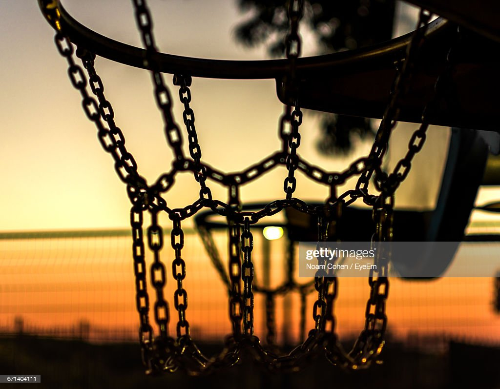 closeup of basketball hoop during sunset stock photo getty images
