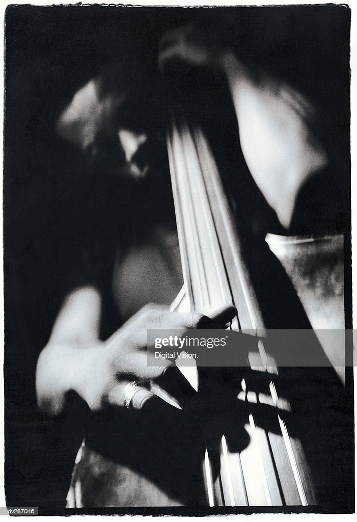 Close-up of bassist playing
