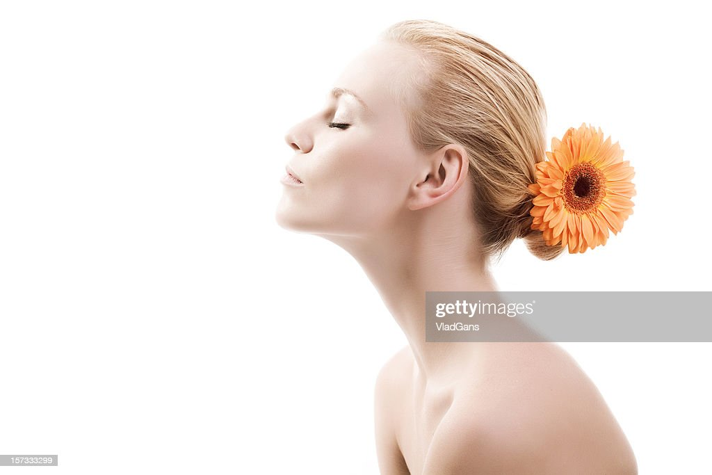 Close-up of beautiful face with flowers : Stock Photo