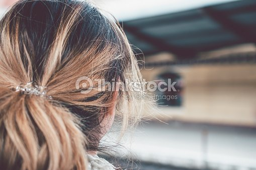 Closeup Of Beautiful Girl With Ombre Colored Hair Looking Away From