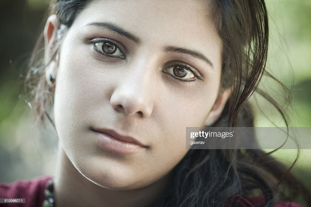 Close-up of beautiful young woman in nature.