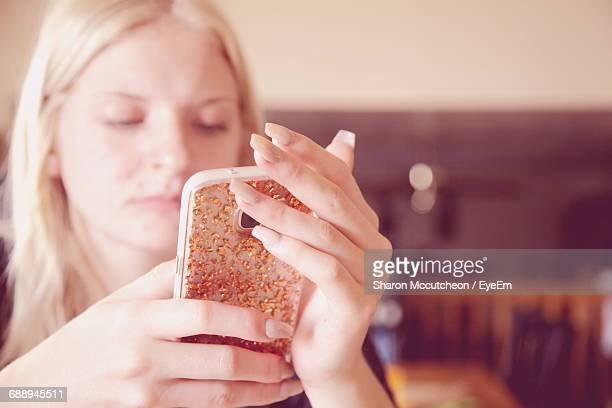 Close-Up Of Beautiful Young Woman Using Mobile Phone