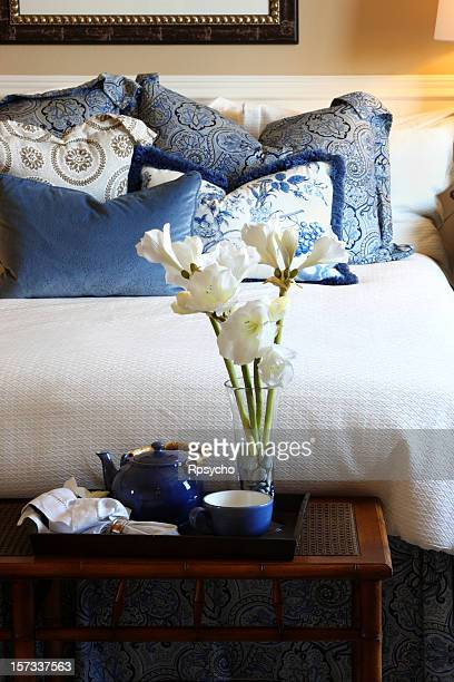 Closeup of bed and bedroom decor in blue and white