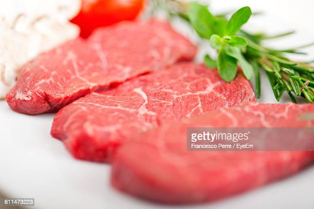 Close-Up Of Beef Slices With Herb Served In Plate