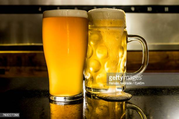 Close-Up Of Beer Glasses On Table At Bar