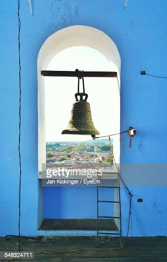 Close-Up Of Bell Against Townscape