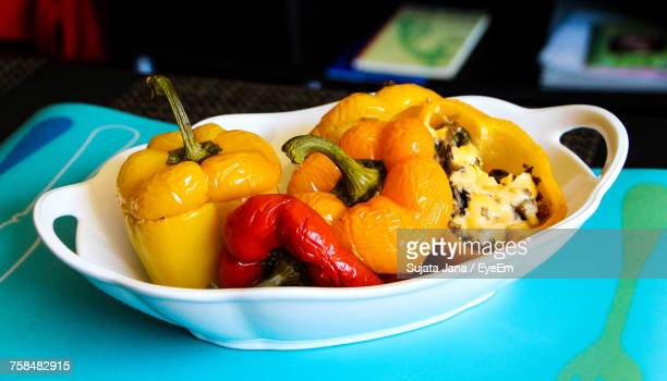 Close-Up Of Bell Peppers In Container On Table