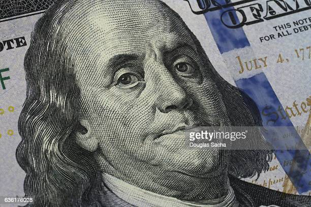 Closeup of Benjamin Franklin's portrait on the One Hundred Dollar Bill