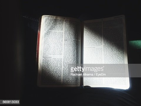Close-Up Of Bible In Dark