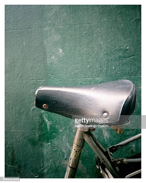 Close-Up Of Bicycle Seat Against Wall
