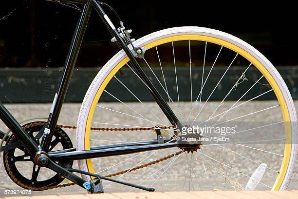 Close-Up Of Bicycle Wheel On Street