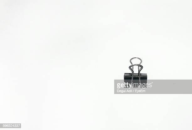 Close-Up Of Binder Clip Against White Background
