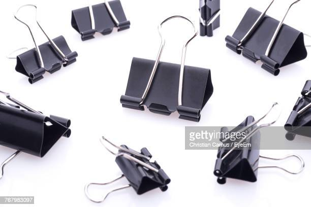 Close-Up Of Binder Clips On White Background