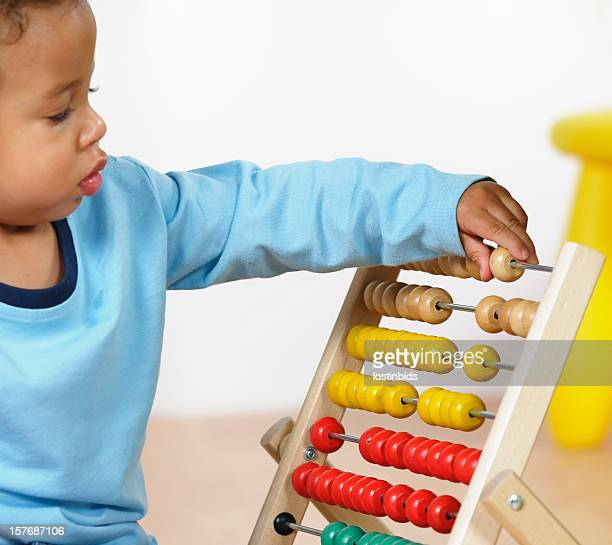 Close-up Of Biracial Baby Boy/ Toddler Playing With An Abacus