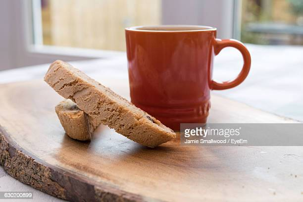 Close-Up Of Biscotti And Coffee On Table